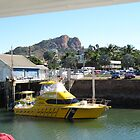 The Coast Guard boat at Townsville Warf, Castle Hill in Background. by Rita Blom