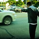 Crazy man pointing at cars. by ahni mazybolton