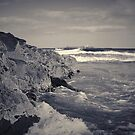 waves crashing against rocks by Phillip Shannon