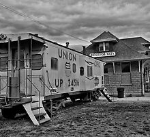 Steel Caboose and Train Depot by Brenton Cooper