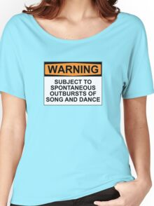 WARNING: SUBJECT TO SPONTANEOUS OUTBURSTS OF SONG AND DANCE Women's Relaxed Fit T-Shirt