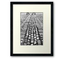 Cobblestone transit Framed Print
