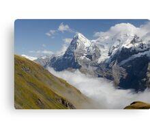 Verdant meadows below the Eiger in Switzerland Canvas Print