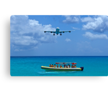 Passenger airplane overflies boat. Canvas Print