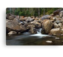 Boulders on the River Canvas Print