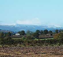 The Black mountains on the England Wales border with a ligh cover of snow by Robert Lewis