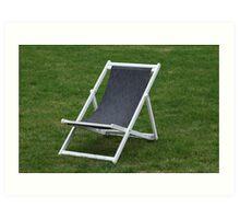 deck chair on green grass Art Print