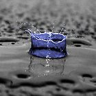 Blue Water Drop On Black Background by Paul Madden