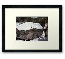 Snow covered Boulder Framed Print