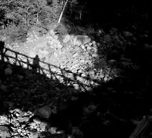 Self-portrait on bridge against rocks by Julie Van Tosh Photography
