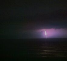 Lightning from the beach by Chris Savage