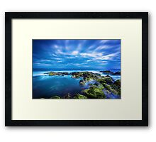 Dusk over calm blue sea over ocean and cloudy sky in Port Fairy, Victoria, Australia Framed Print