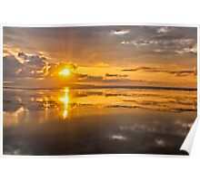 Rising sun, reflections and clouds at dawn seen in Sanur Beach in Bali, Indonesia Poster