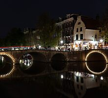 Light Trails and Circles - Reflecting on Magical Amsterdam Canals by Georgia Mizuleva