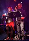 A photograph of musicians playing live on stage in Derry on Halloween night