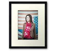 Vintage fashion shot of young woman in front of US and UK flags Framed Print