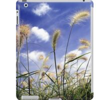 Feathery grasses against a blue summer sky iPad Case/Skin