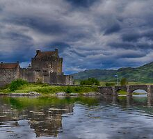 Storm clouds over Eilean Donan Castle by EileenW