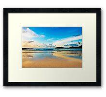 dramatic scene of sunset on the beach Framed Print