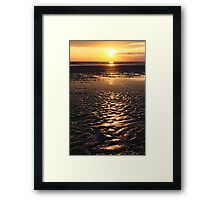 sunset on sand beach Framed Print