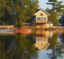 wooden boat with reflection near cottage St. Lawrence River by David Galson