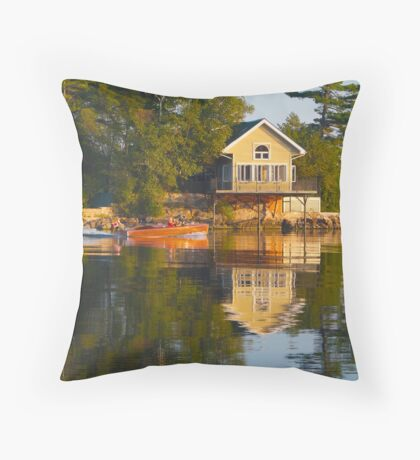 wooden boat with reflection near cottage St. Lawrence River Throw Pillow
