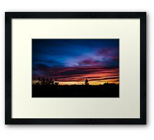 Colorful sunset with dramatic clouds Framed Print
