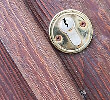 Wooden door with a keyhole brass by vladromensky