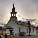 Sun Setting Behind The Rose Valley Church by Gene Walls