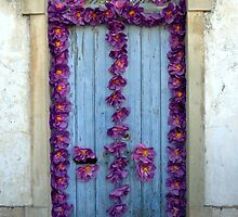 Old door decorated with purple paper flowers by juliedawnfox