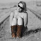 A Woman Just needs her boots by Jessie Miller/Lehto