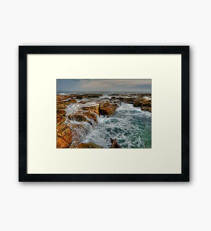 Sea Covered Rocks Framed Print