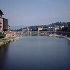 Looking downstream on Arno from Ponte Vecchio Florence Italy 198407080052m by Fred Mitchell