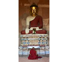 Monk praying to Buddha statue in Bagan Photographic Print
