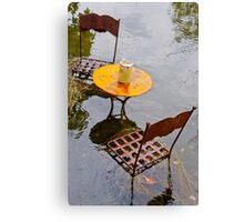 Submerged metal chairs and table Canvas Print