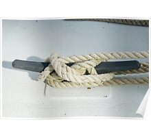 Rope tied fast around boat cleat Poster