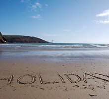 Holiday word in sand on beach, Salcombe, Devon, United Kingdom by silverportpics