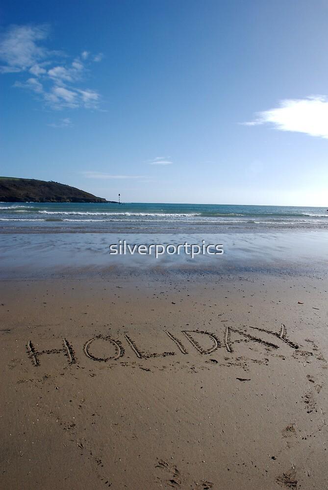 Holiday word in sand on beach, Salcombe, Devon, United Kingdom by silverportpics