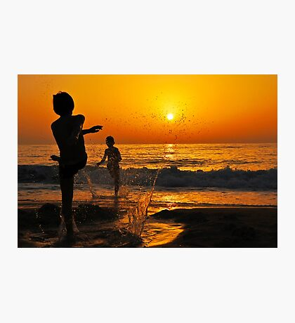 children playing on the Beach at sunset Photographic Print