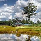 Reflection Of A Barn by Kathy Baccari