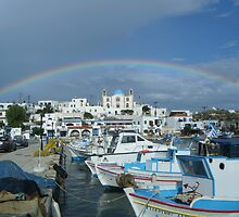 Full rainbow over church in Greek Island by SlavicaB
