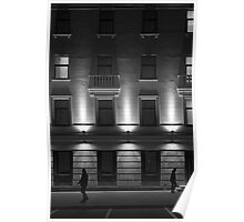 Illuminated Building with People Poster