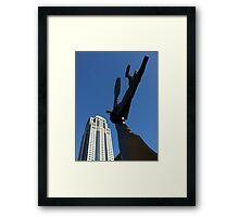 Hammering Man on a sunny, fall day. Framed Print