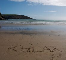 Relax word in sand on beach, Salcombe, Devon, United Kingdom by silverportpics