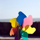 Colourful toy beach windmill, Salcombe, Devon, UK by silverportpics