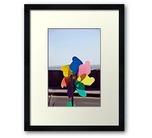 Colourful toy beach windmill, Salcombe, Devon, UK Framed Print