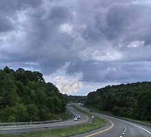Cloud Watching While Traveling Through America's Heartland by Gene Walls
