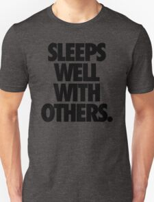 SLEEPS WELL WITH OTHERS. T-Shirt