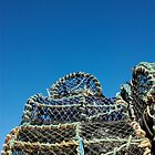 Lobster pots piled on harbourside, Salcombe, Devon, UK by silverportpics