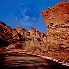 Full Earth Over Red Rocks by Kellice